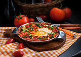 Shakshuka with tomatoes and eggs