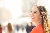 Beauty woman with perfect smile and white teeth on the street