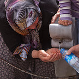 Turkish Woman Collects Water