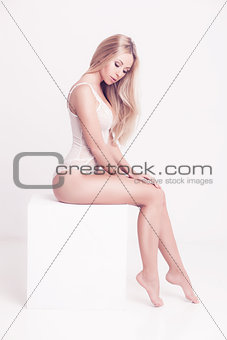 blond woman with long hair in white underwear