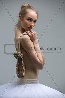 Portrait of young ballerina in white tutu