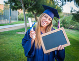 Woman Holding Diploma and Blank Chalkboard Wearing Cap and Gown