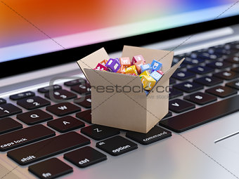 App icons and buttons in cardboard box on the laptop keyboard