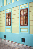 Blue house facade with wooden windows from Sighisoara city old c