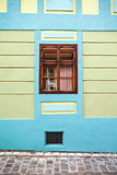 Blue house facade with wooden window from Sighisoara city old ce