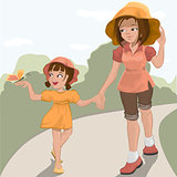 Mother walks with her daughter in the park