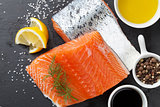 Salmon and spices on stone table