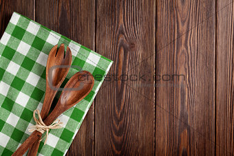 Kitchen cooking utensils over wooden table