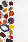 Various spices on white wooden background