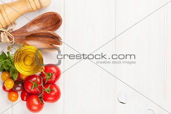 Fresh colorful tomatoes, basil and olive oil