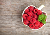 Fresh ripe raspberries bowl