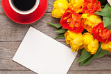 Colorful tulips, greeting card and coffee cup