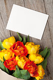 Colorful tulips bouquet and blank greeting card