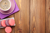 Colorful macaron cookies and cup of coffee