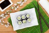 Sushi maki set and sakura branch
