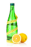 Water bottle, measuring tape and fresh lemons