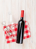 Red wine bottle, glass and corkscrew