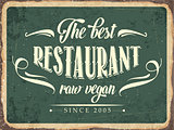 "Retro metal sign "" The best restaurant raw vegan"""