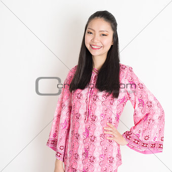 Asian girl in pink batik dress
