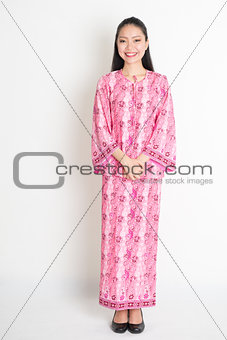 Asian woman in pink batik dress
