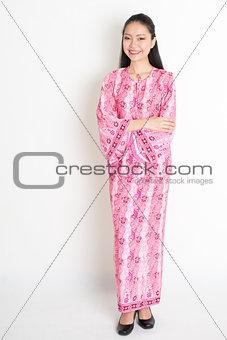 Portrait of Asian girl in pink batik dress