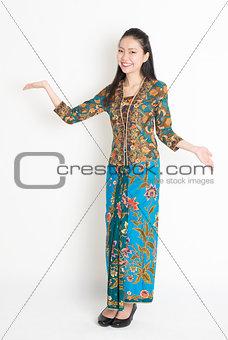 Asian girl showing something