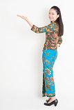 Asian female hand holding something