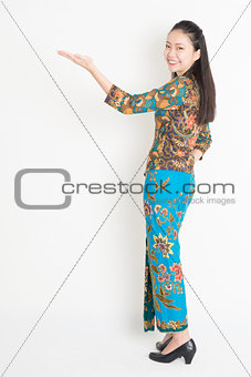 Asian female hand holding something