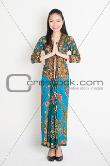 Asian female greeting