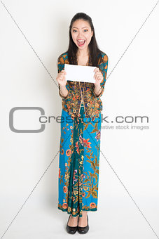 Asian female holding an envelope