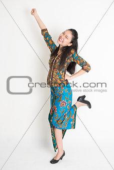 Happy Asian female cheering