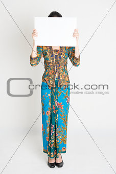Asian girl holding placard covering face