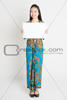 Asian girl holding a poster