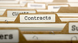 Contracts Concept with Word on Folder.