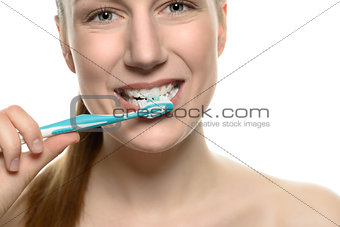 Attractive naked woman brushing her teeth