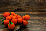 Cherry tomatoes on a rustic background