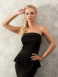 blond elegant woman near fashion wall