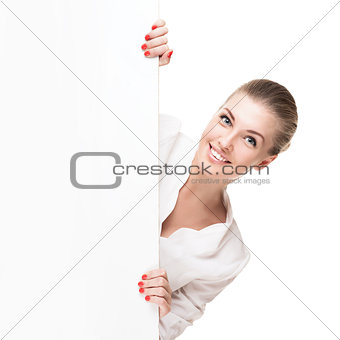 Smiling blond woman holding signboard
