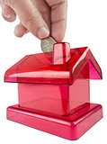 red house shaped piggy bank