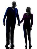 couple senior walking holding hands silhouette