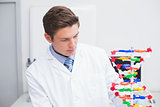 Scientist looking at dna model