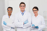 Scientists smiling and looking at camera