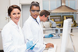 Smiling scientists working together