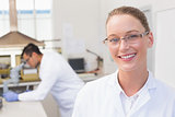 Happy scientist smiling at camera