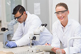 Scientists using microscope
