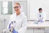 Scientists using microscope
