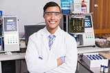 Happy scientist smiling at camera with arms crossed