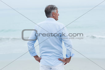 Thoughtful man standing by the sea