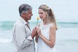 Happy man offering flower to his girlfriend