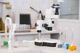 Microscope and beakers